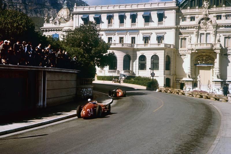 Masten Gregory leads Giorgio Scarlatti (both Maserati 250F) heading towards the casino, 1957 Monaco Grand Prix.