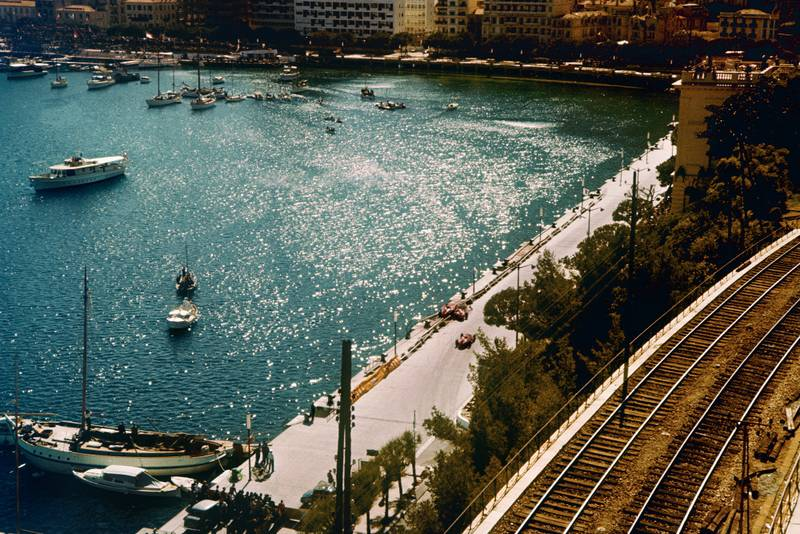 The stricken cars of Mike Hawthorn and Peter Collins lie next to the harbour at the 1957 Monaco Grand Prix.