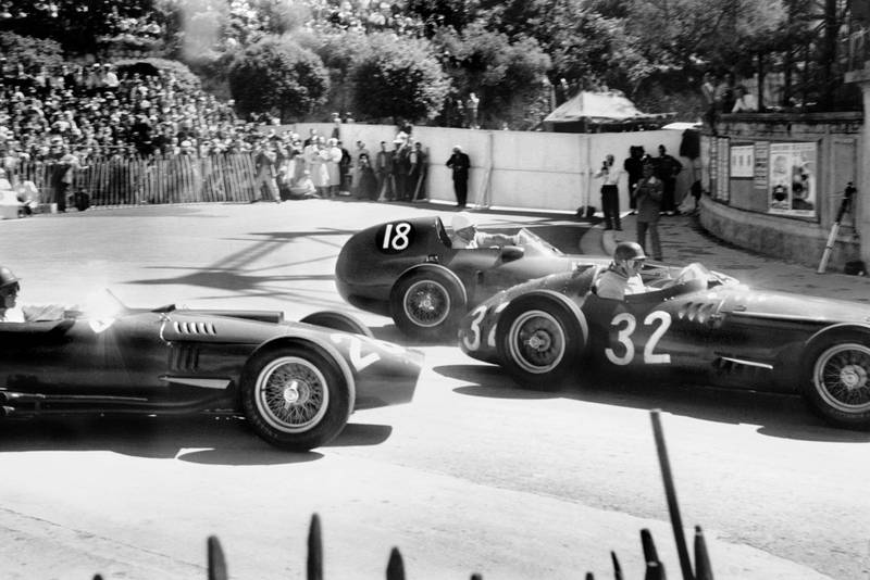 an Manuel Fangio (Maserati 250F), 1st position, leads Stirling Moss (Vanwall VW3), retired and Peter Collins (Lancia-Ferrari D50), retired, at the start of the 1957 Monaco Grand Prix.