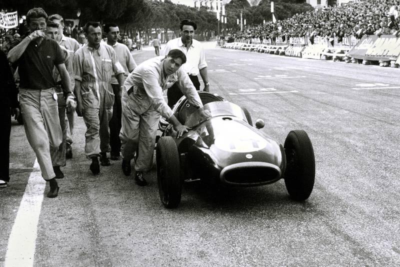 Jack Brabham pushes his Cooper across the finish line at the 1957 Monaco Grand Prix.