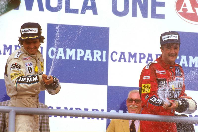 Nelson Piquet, 1st position with teammate Nigel Mansell, 3rd, on the podium.