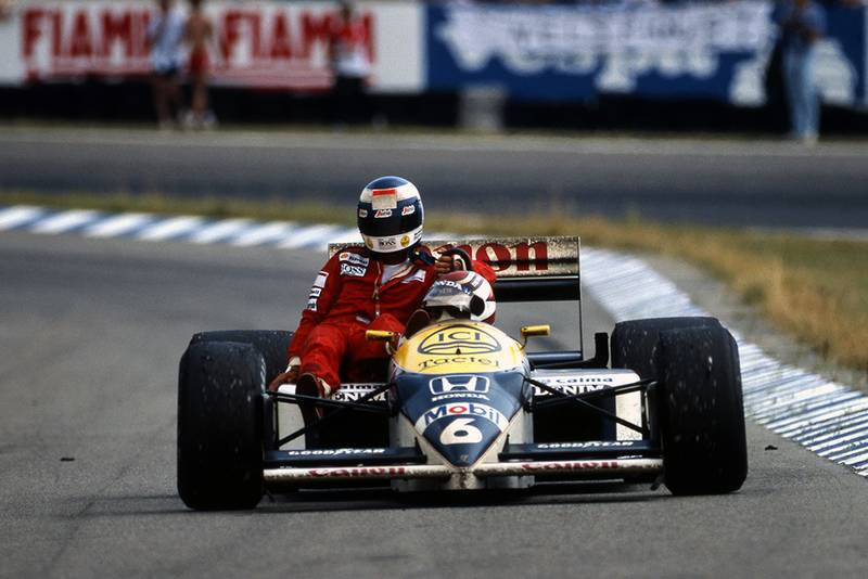 Winner Nelson Piquet gives Keke Rosberg a lift back to the pits.
