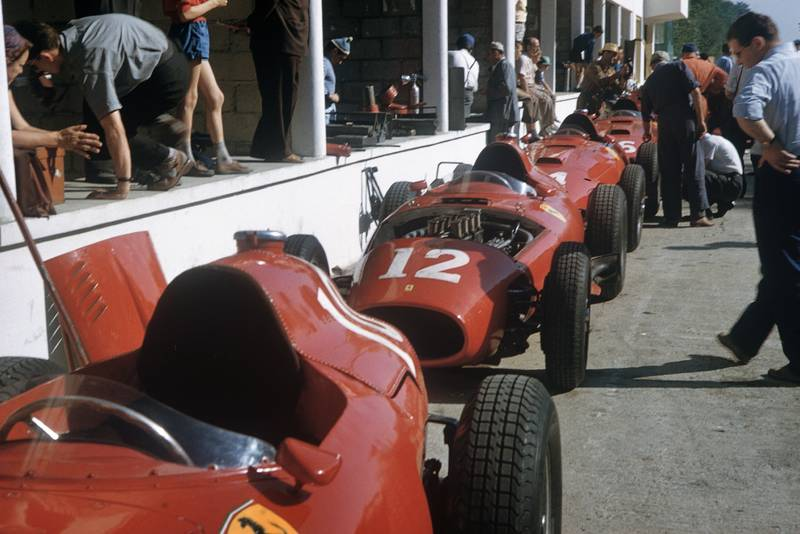 The Lancia-Ferrari 801 chassis of the Scuderia Ferrari team line up astern in the pit lane, ready to be worked on, 1957 French GP, Rouen.