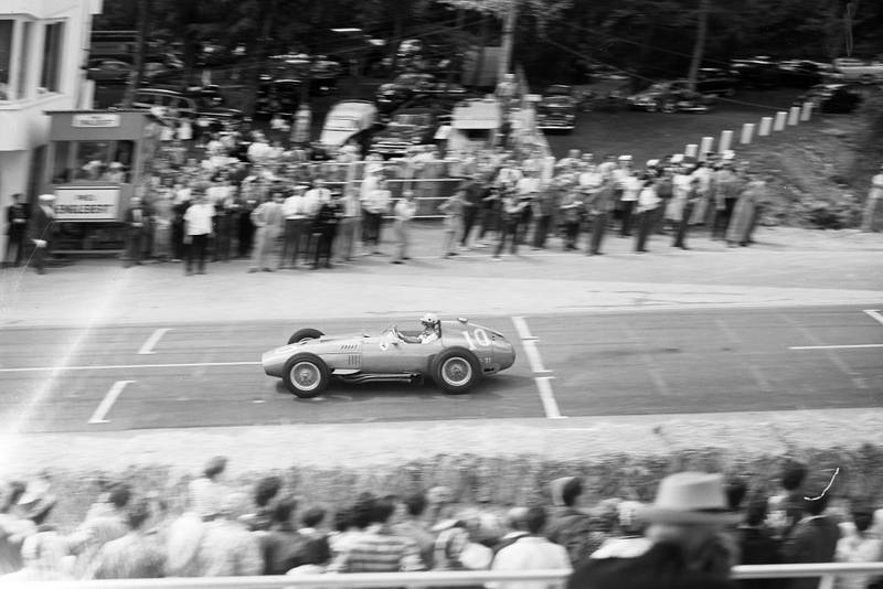 Luigi Musso, Ferrari D50, at the 1957 French Grand Prix, Rouen, racing past the crowd by the start finish line.
