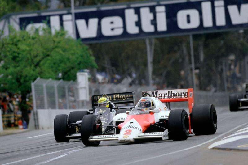 Keke Rosberg (McLaren MP4/2 TAG Porsche) leads Ayrton Senna (Lotus Renault).