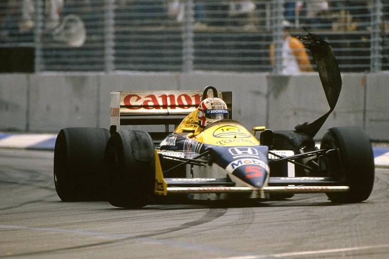 Nigel Mansell saw his World Championship bid end when his rear tyre blew on the Brabham Straight on lap 64.