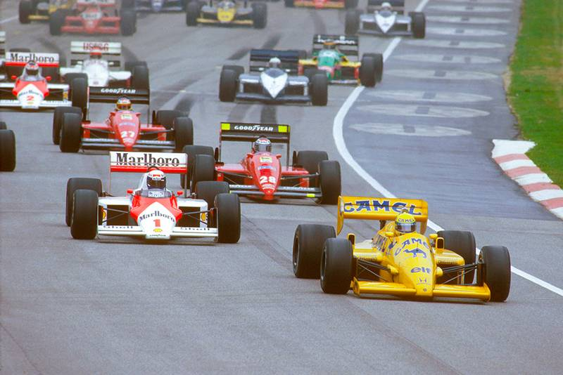 Ayrton Senna (Lotus 99T Honda) leads Alain Prost (McLaren MP4/3 TAG Porsche) and Gerhard Berger (Ferrari 187) at the start.