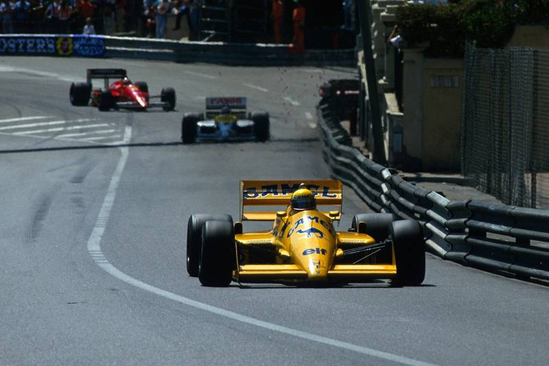 Ayrton Senna leads in his Lotus 99T.