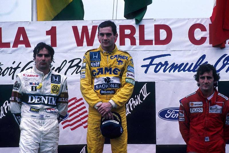 Ayrton Senna, 1st place (C), with Nelson Piquet, 2nd (L) and Alain Prost 3rd place (R) on the podium.