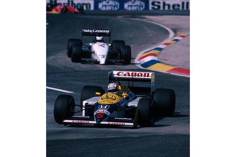 Winner Nigel Mansell in his Williams FW11B.