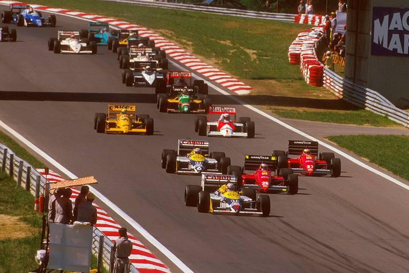 Nigel Mansell (Williams FW11B Honda) leads Gerhard Berger and Michele Alboreto (both Ferrari F187's), Nelson Piquet (Williams FW11B Honda), Alain Prost (McLaren MP4/3 TAG Porsche) and Ayrton Senna (Lotus 99T Honda) at the start.