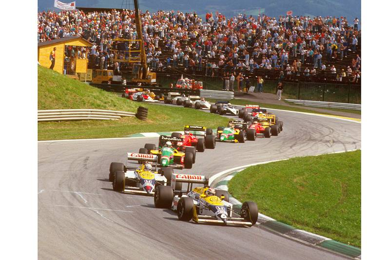 Nelson Piquet leads teammate Nigel Mansell (both Williams FW11B Honda's), Teo Fabi (Benetton B187 Ford) and Gerhard Berger (Ferrari F187) at the start.