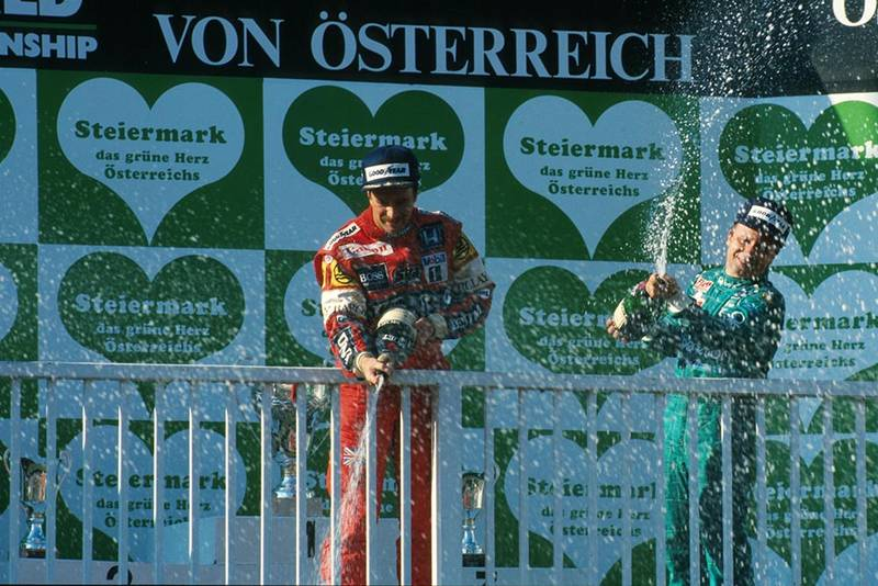 Winner Nigel Mansell and 3rd place Teo Fabi celebrate on the podium.