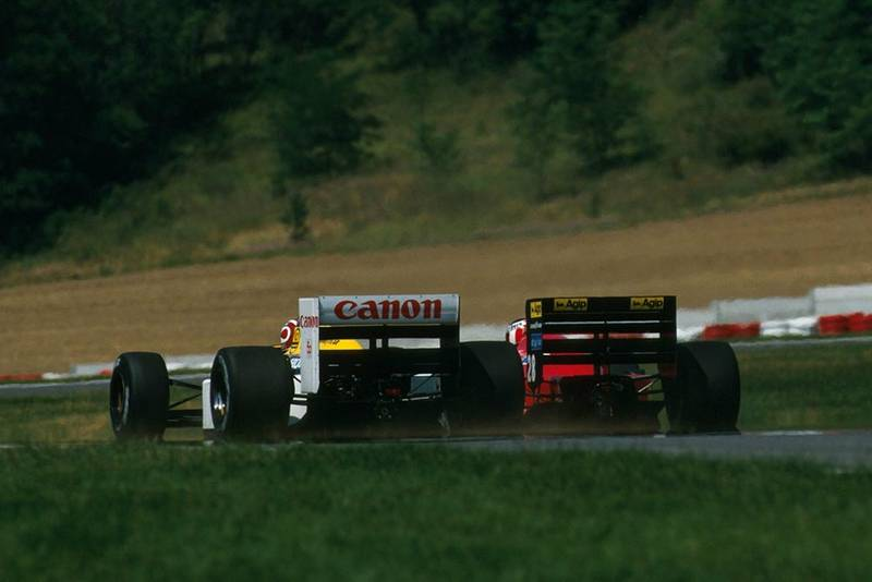 Nelson Piquet, Williams FW11B, and Gerhard Berger, Ferrari F1/87, battle.