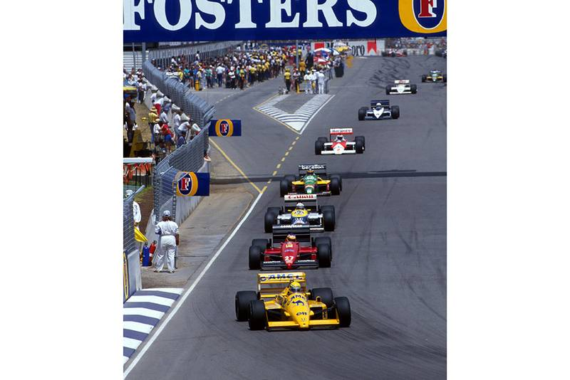 Ayrton Senna leads the pack in his Lotus 99T.
