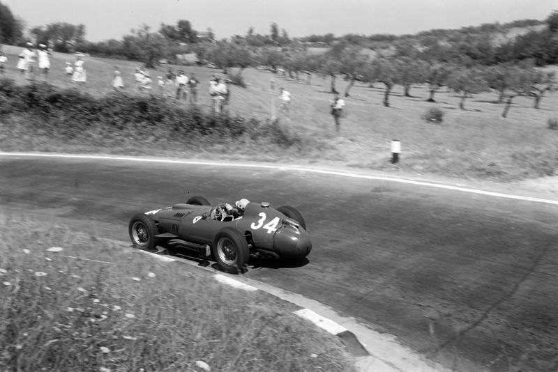 Luigi Musso pushing hard in his Ferrari at the 1957 Pescara Grand Prix.