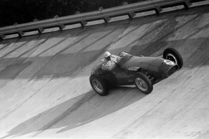 Harry Schell takes to the banking in his Vanwall