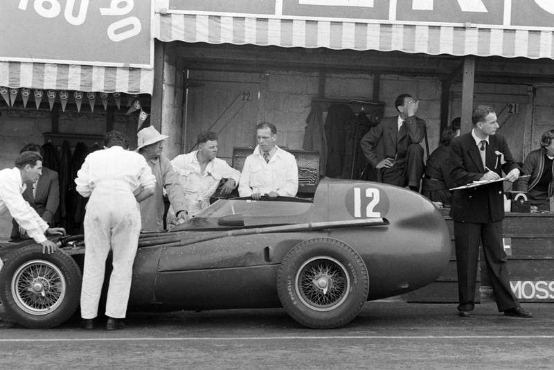 Trintignant's Vanwall is seen to in the pits