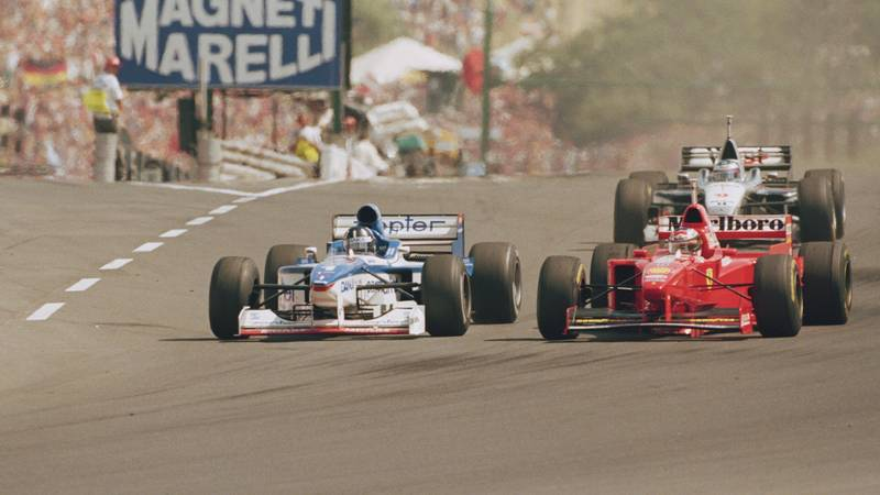 Damon Hill in an Arrows overtakes Michael SAchumacher's Ferrari during the 1997 Hungarian Grand Prix