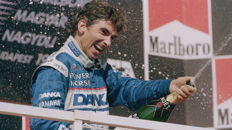 Damon Hill on the podium after finishing second in the 1997 F1 Hungarian Grand Prix driving an Arrows
