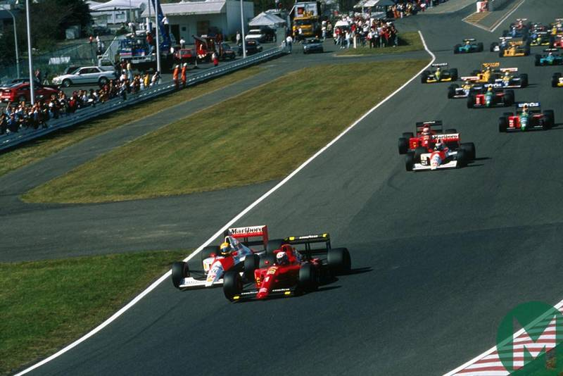 Ayrton Senna and Alain Prost head into the first corner at the 1990 Japanese Grand Prix