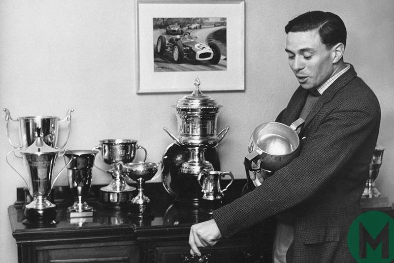 Jim Clark shows his trophies at home