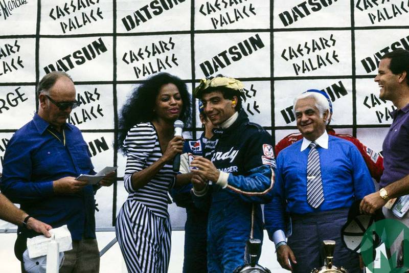 Tyrrell driver Michele Alboreto is congratulated by Diana Ross after winning the 1981 Las Vegas GP