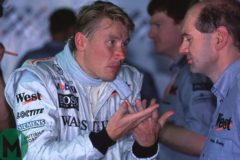 Mika Hakkinen confers with McLaren-Mercedes technical director Adrian Newey