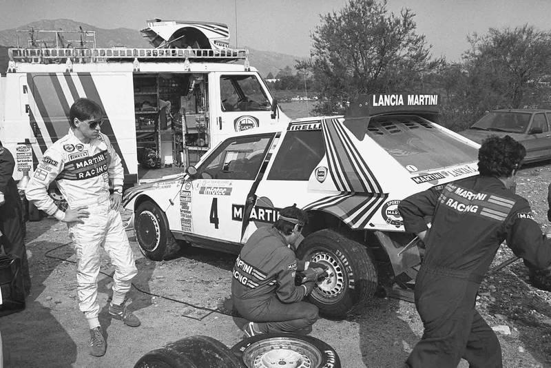 Henri Toivonen watches his mechanics setting up the Lancia Delta Rally Corsica 1986