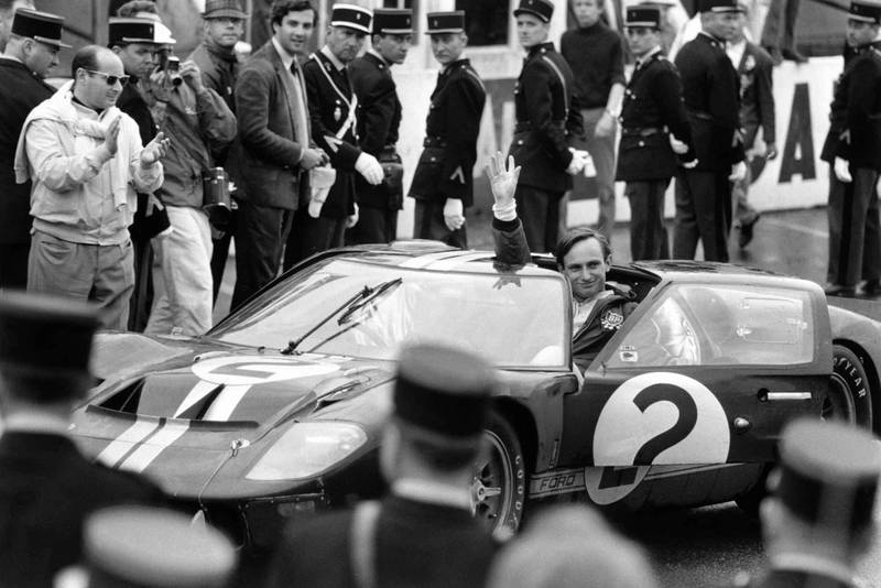 Chris Amon greets the crowds after winning the 1966 Le Mans in his Ford GT40