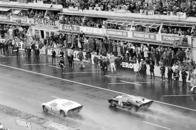 The two Ford GT40s approach the line