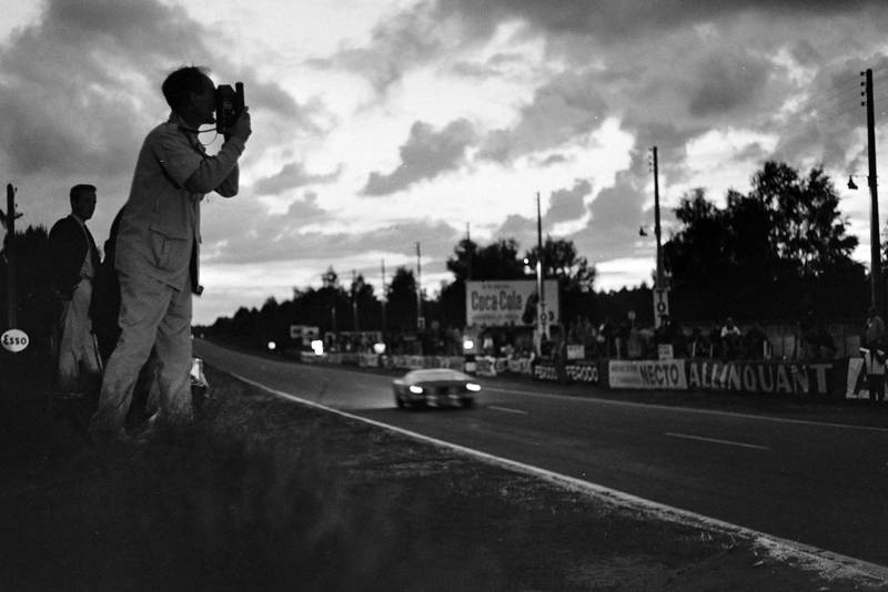 A photographer catches a passing Ford GT40 at dawn