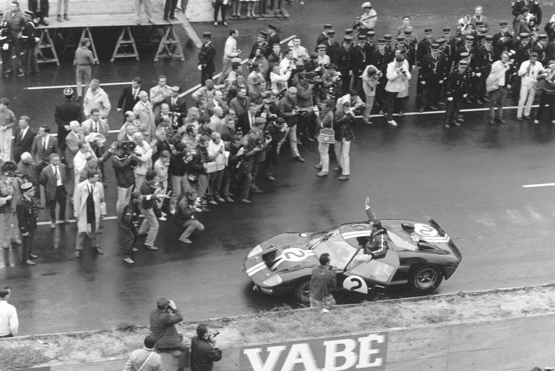Chris Amon faces the press after taking the Le Mans 1966 win with Bruce McLaren in the Ford GT40 MkII