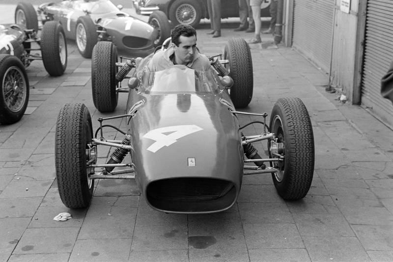 Bandini brings his Ferrari into the paddock
