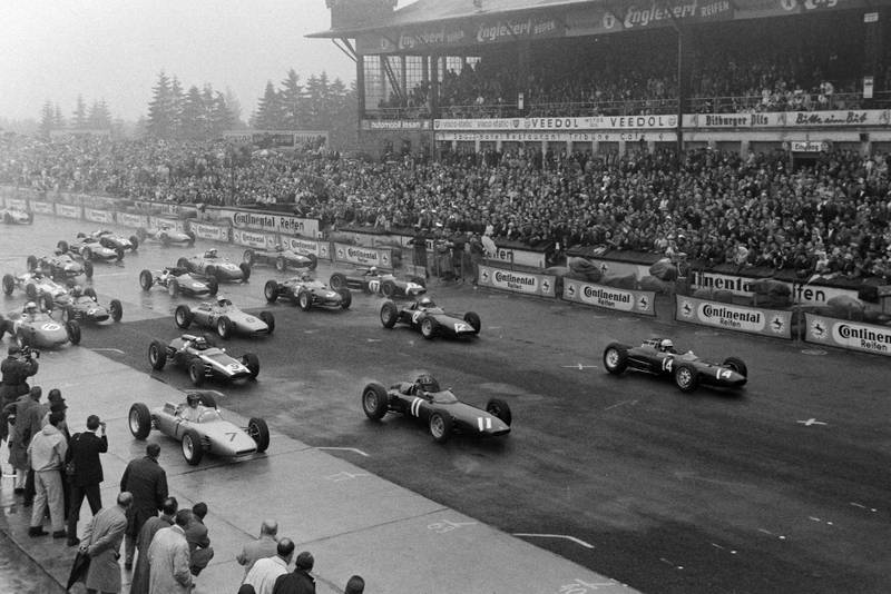 Cars pull tentatively away from the grid
