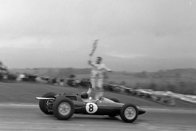 Jim Clark, Lotus 25 Climax, takes the chequered flag.