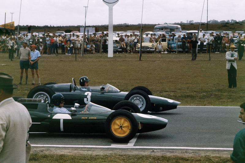 Graham Hill (BRM P57) and Jim Clark (Lotus 25 Climax) line up on the front row of the grid for their championship decider.