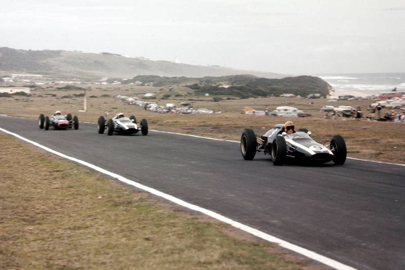 Tony Maggs leads Bruce McLaren (both Cooper T60 Climax's) and John Surtees (Lola Mk4 Climax). McLaren and Maggs finished in 2nd and 3rd positions respectively.