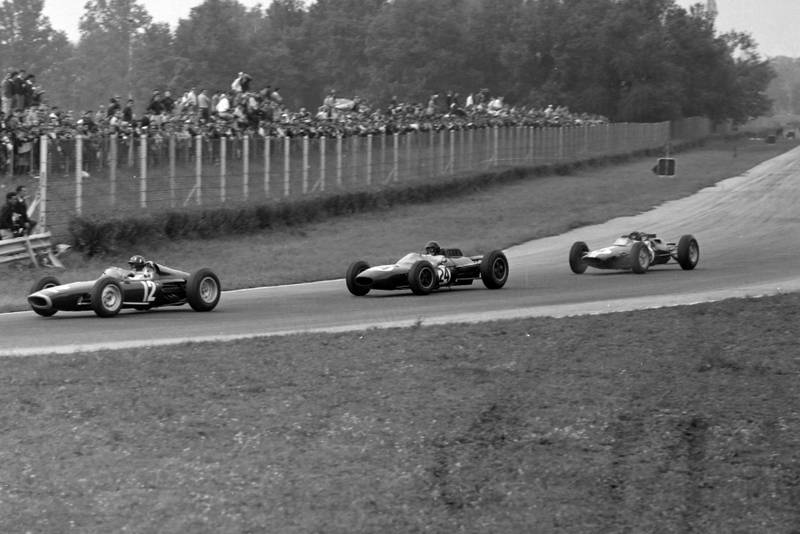 Graham Hill, BRM P61, leads Dan Gurney, Brabham BT7 Climax, and Jim Clark, Lotus 25 Climax.