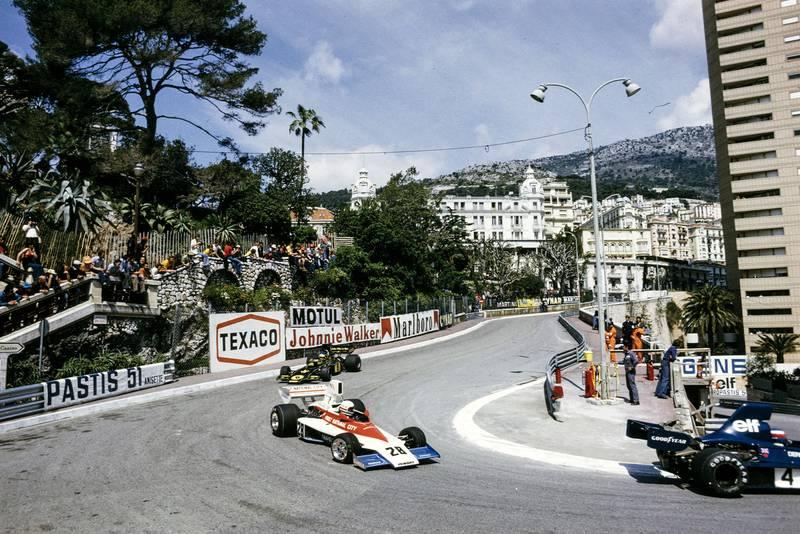 Mark Donahue (Penske) leads Jacky Ickx (Lotus) at Loews during the 1975 Monaco Grand Prix.