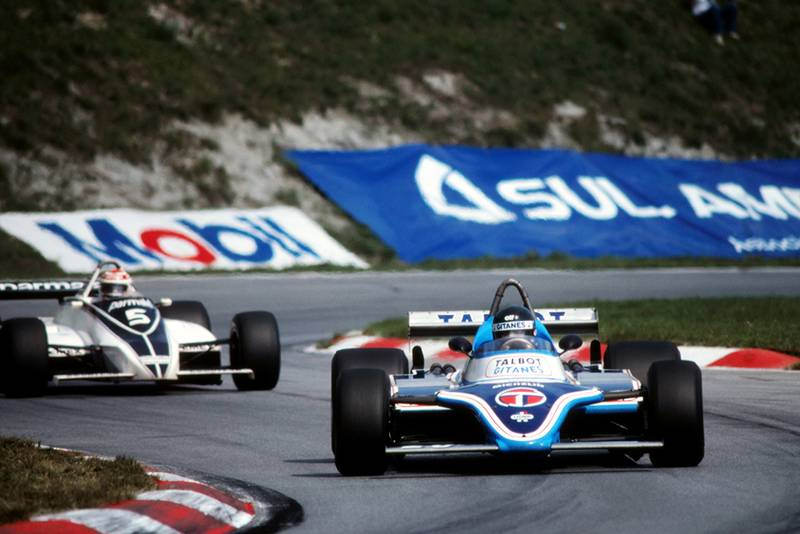 Race winner Jacques Laffite in a Ligier JS17, followed by Nelson Piquet in his Brabham BT49C.