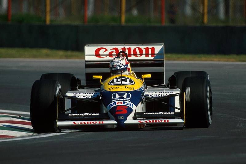 Mexican GP winner Nigel Mansell in his Williams FW11B.