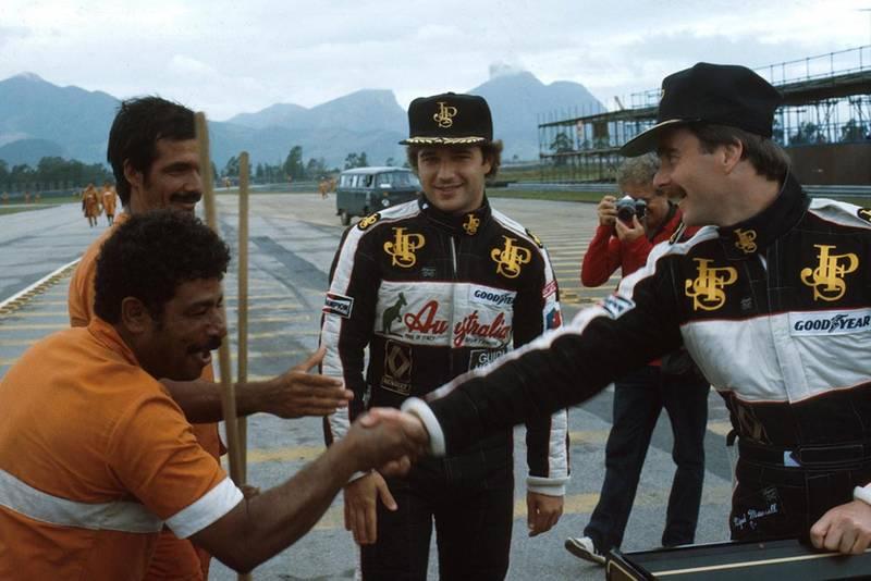 Elio de Angelis, left and Nigel Mansell meet the locals.