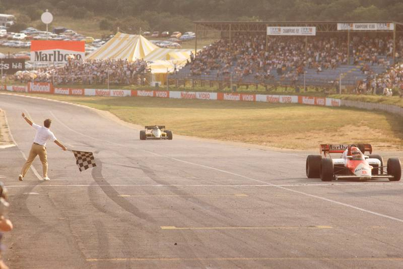 Niki Lauda (McLaren MP42 TAG Porsche) takes the chequered flag.