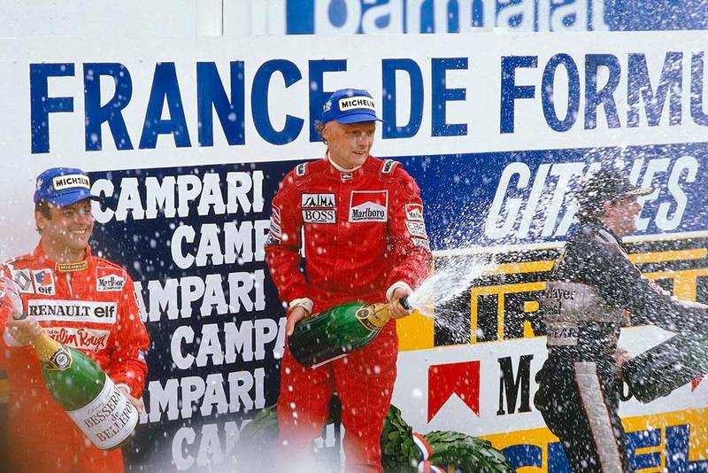 Niki Lauda, 1st position, Patrick Tambay, 2nd position and Nigel Mansell, 3rd position on the podium.