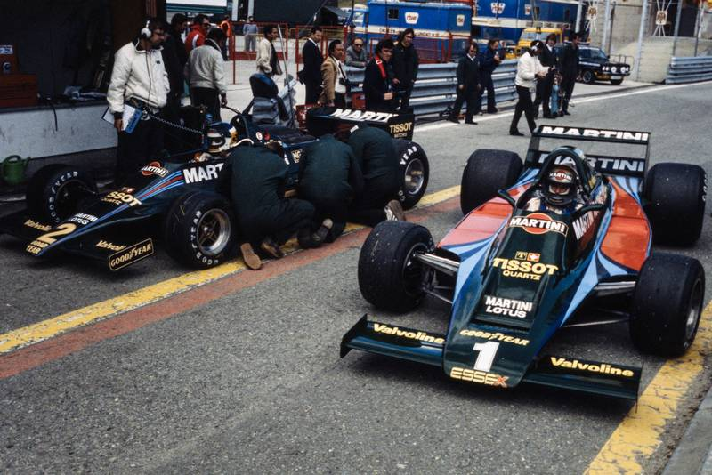 The Lotus team prepare their cars in the pits at the 1979 Spanish Grand Prix, Jarama.