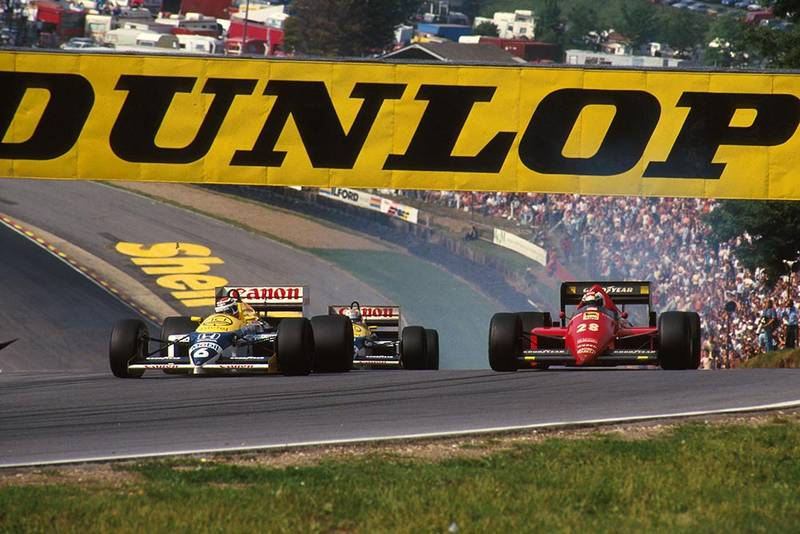 Nelson Piquet (Williams FW11) passes the Ferrari F186 of Stefan Johansson.