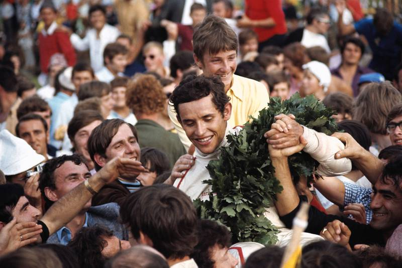 Jacky Ickx is surrounded by fans and press after winning the 1970 Austrian Grand Prix.