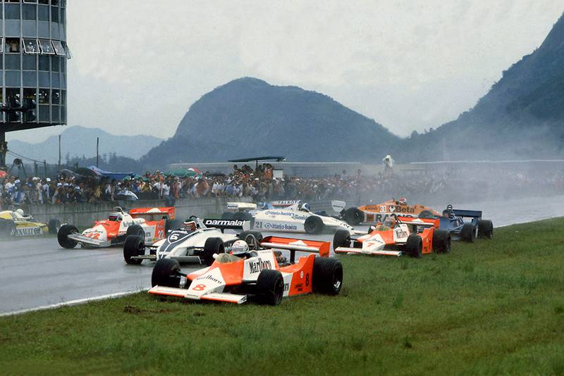Chaos at the start with Andrea de Cesaris (#8 McLaren M29F-Ford Cosworth), Hector Rebaque (#6 Brabham BT49C-Ford Cosworth), Mario Andretti (#22 Alfa Romeo 179C), Rene Arnoux (#16 Renault RE20), John Watson (#7 McLaren M29F-Ford Cosworth), Chico Serra (#21 Fittipaldi F8C-Ford Cosworth), Ricardo Zunino (Tyrrell 010-Ford Cosworth), Siegfried Stohr (#30 Arrows A3-Ford Cosworth) and Jean-Pierre Jarier (Ligier JS17-Matra) are all involved in an accident on the grid.
