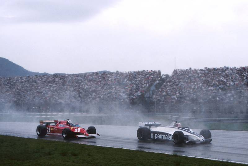 Hector Rebaque in a Brabham BT49C, leads Didier Pironi in hs Ferrari 126CK.